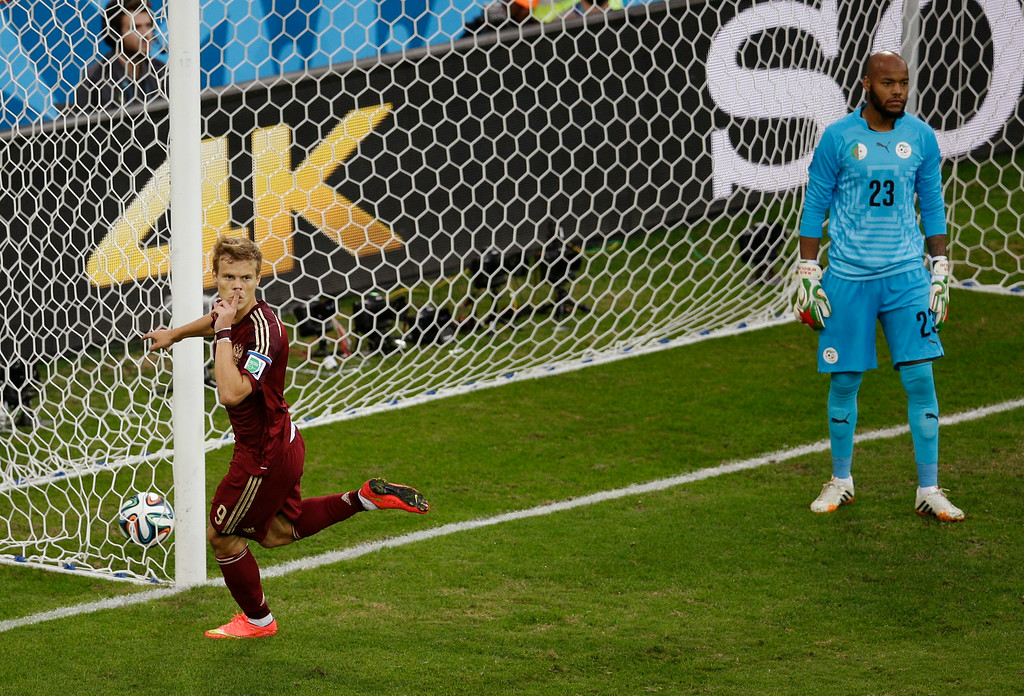 . Russia\'s Alexander Kokorin, left, celebrates scoring his side\'s first goal during the group H World Cup soccer match between Algeria and Russia at the Arena da Baixada in Curitiba, Brazil, Thursday, June 26, 2014. (AP Photo/Michael Sohn)