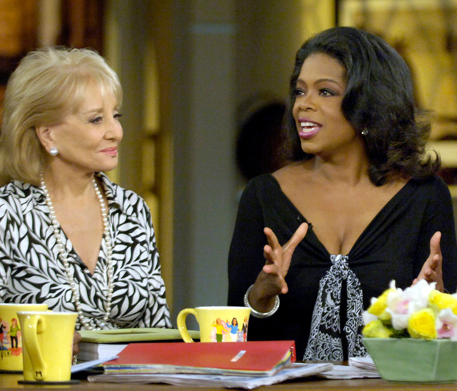 . Talk show host Oprah Winfrey, right, joins Barbara Walters, co-host of The View at ABC studios in New York, Friday, May 12, 2006. It was Winfrey\'s first appearance on the show. (AP Photo/ABC, Steve Fenn)