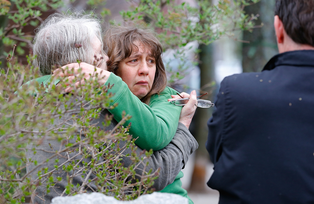 . A woman reacts while being questioned by the Cambridge Police and other law enforcement agencies on April 19, 2013 near the home of suspect #2 on Norfolk Street in Cambridge, Massachusetts. Earlier, a Massachusetts Institute of Technology campus police officer was shot and killed late Thursday night at the school\'s campus in Cambridge. A short time later, police reported exchanging gunfire with alleged carjackers in Watertown, a city near Cambridge. According to reports, one suspect has been killed during a car chase and the police are seeking another - believed to be the same person (known as Suspect Two) wanted in connection with the deadly bombing at the Boston Marathon earlier this week. Police have confirmed that the dead assailant is Suspect One from the recently released marathon bombing photographs. (Photo by Jared Wickerham/Getty Images)