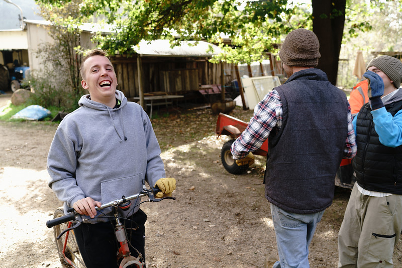 Two Young Men on a Farm Laughing with Each Other