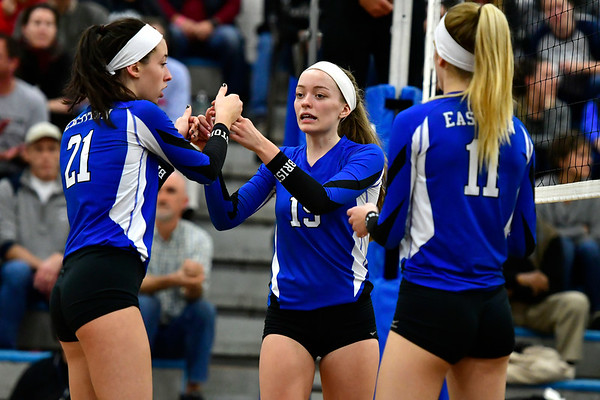 11/8/2018 Mike Orazzi | Staff Bristol Eastern High School's Aliana Rivoira (21), Amber Blais (19) and Ryley Plourde (11) during the Class L Second Round State Girls Volleyball Tournament in Bristol Thursday night.