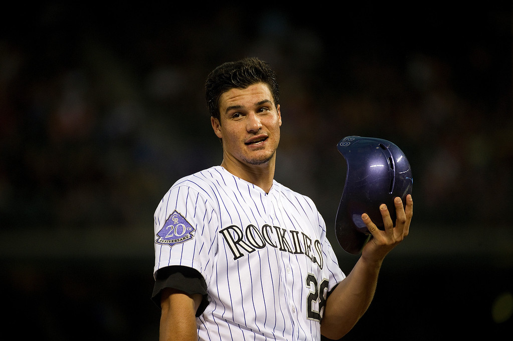 . DENVER - JUNE 28: Nolan Arenado of the Colorado Rockies talks to the third base coach during the third inning of a baseball game against the San Francisco Giants on June 28, 2013 at Coors Field.  (Photo By Grant Hindsley / The Denver Post)
