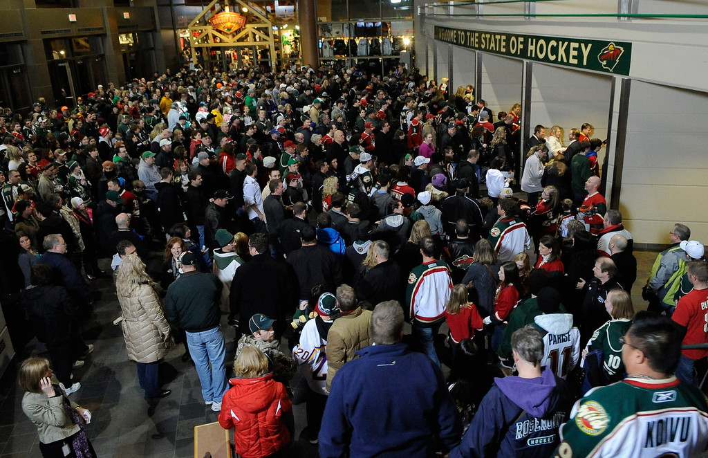 . ST. PAUL, MN - JANUARY 19:  Fans wait for the gates open for the game between the Minnesota Wild and the Colorado Avalanche on January 19, 2013 at Xcel Energy Center in St. Paul, Minnesota.  (Photo by Hannah Foslien/Getty Images)