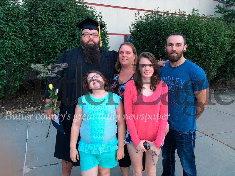 Mitch Langston of Prospect and his family gather after he received his high school equivalency diploma at a graduation ceremony at BC3 Thursday. In the photo, front left, are his daughters Julia and Joelle. Next to Mitch is his wife Jessica and brother Kenny.