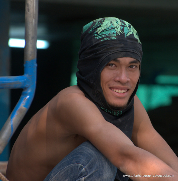 Construction worker during a break at a building on Krung Thonburi road  in Bangkok, Thailand in December 2009