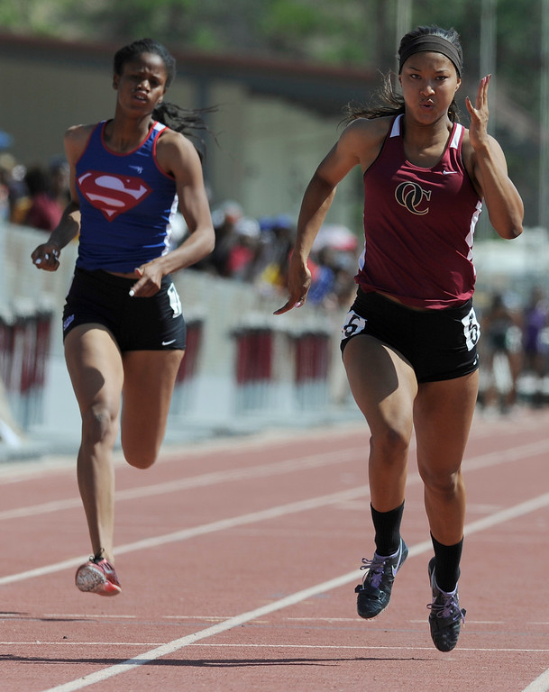 . Megan George from Serra can not catch Schuyler Moore from Oaks Christion. Moore won the girls 100 meters in the 2013 CIF Southern Section Track & Field Divisional Finals held at Mt. San Antonio College in Walnut, CA 5/18/2013(John McCoy/LA Daily News)