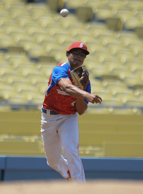 . Serra third baseman Tim Ravare makes the throw to first for an out on Mira Costa in the CIF-SS Division III championship baseball game Friday at Dodger Stadium. Serra won the title, 8-1. 20130531 Photo by Steve McCrank / Staff Photographer