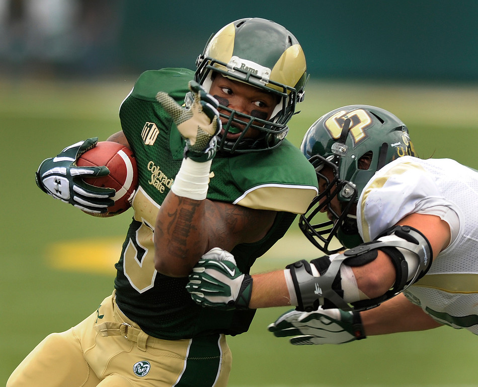 . FORT COLLINS, CO. - SEPTEMBER 14: Rams running back Kapri Bibbs (5) tried to get around the corner in the first half. The Colorado State University football team hosted Cal Poly at Hughes Stadium in Fort Collins Saturday afternoon, September 14, 2013.  Photo By Karl Gehring/The Denver Post