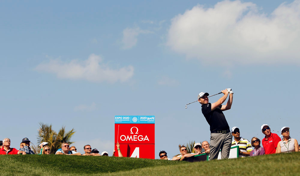 . Stephen Gallacher of Scotland plays a ball on the 4th hole during the final round of the Dubai Desert Classic Golf tournament in Dubai, United Arab Emirates, Sunday, Feb. 3, 2013. (AP Photo/Kamran Jebreili)