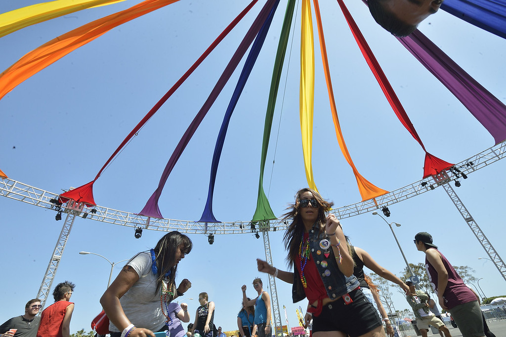 . LONG BEACH, CALIF. USA --  Biviana Alvarado, left, and Joseline Arroyo, right, dance during the 30th annual Long Beach (Calif.) Lesbian & Gay Pride celebration Saturday, May 18, 2013. Photo by Jeff Gritchen / Los Angeles Newspaper Group
