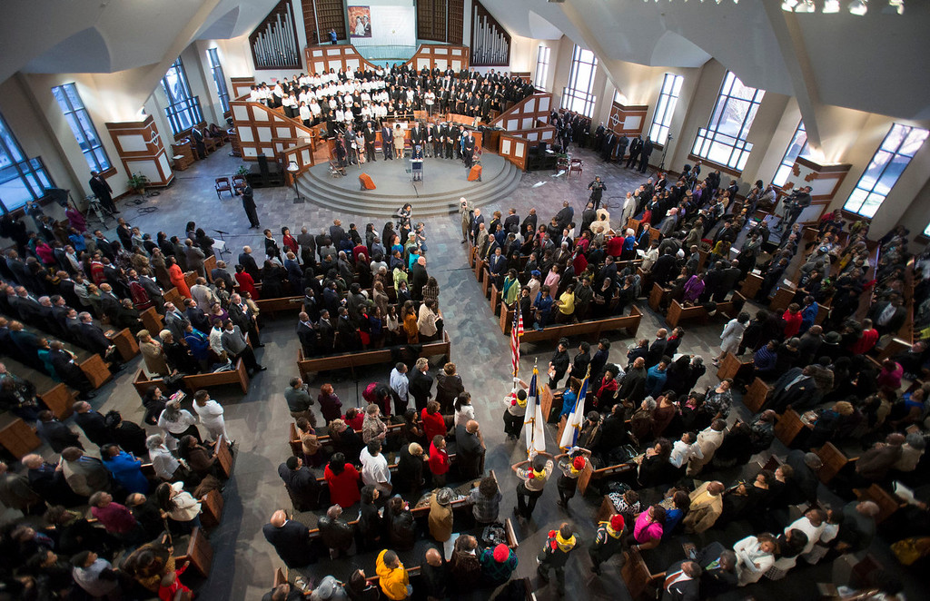 . The presentation of the flags of the nations is performed before the start of the Rev. Martin Luther King Jr. holiday commemorative service at Ebenezer Baptist Church Monday, Jan. 20, 2014, in Atlanta. (AP Photo/Jason Getz)