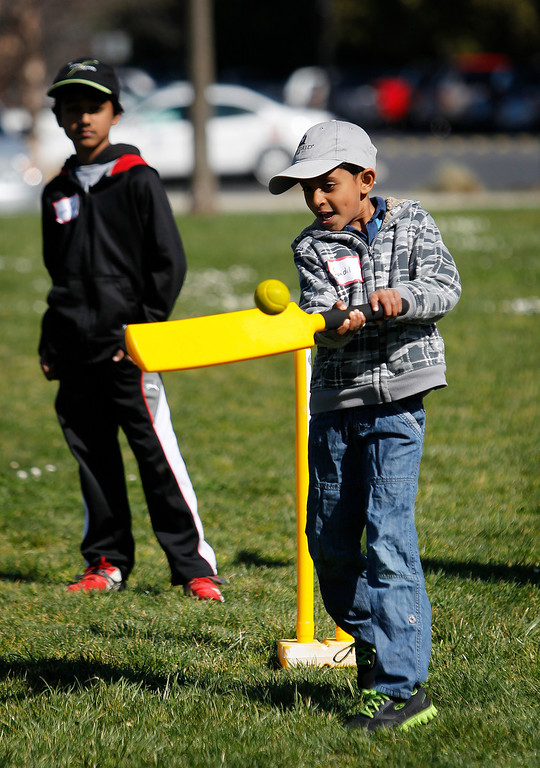 . Sandil Emani, 5, bats at the cricket festival sponsored by the California Cricket Academy at the Cupertino Library Field\'s cricket pitch in Cupertino, Calif. on Saturday, March 9, 2013.  Boys and girls ages 5-13 were invited to attend and learn the basics of the game.  (LiPo Ching/Staff)
