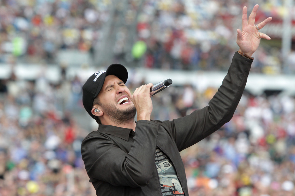 . Musician Luke Bryan performs during pre-race ceremonies for the NASCAR Sprint Cup Series Daytona 500 at Daytona International Speedway on February 23, 2014 in Daytona Beach, Florida.  (Photo by Jerry Markland/Getty Images)