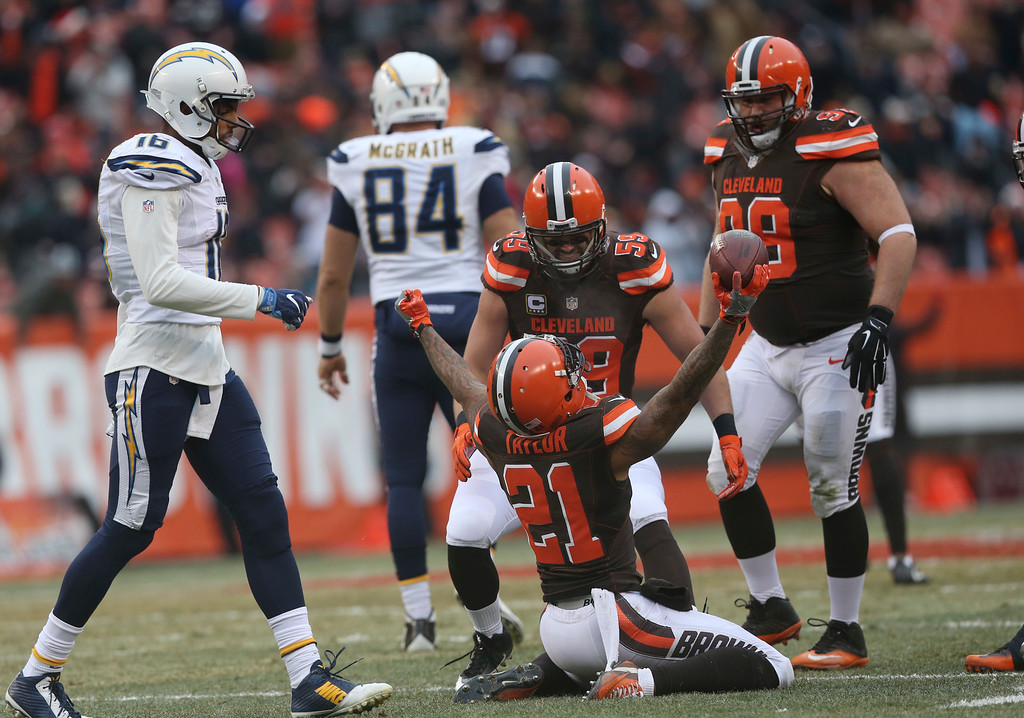 . Cleveland Browns cornerback Jamar Taylor (21) reacts after an interception in the first half of an NFL football game against the San Diego Chargers, Saturday, Dec. 24, 2016, in Cleveland. (AP Photo/Aaron Josefczyk)
