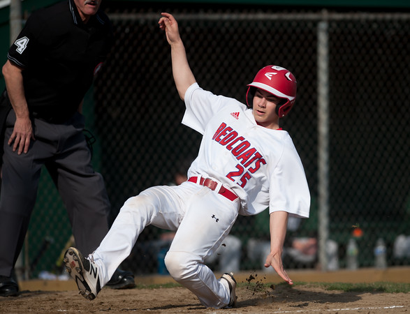 04/13/18 Wesley Bunnell   Staff Berlin High School baseball defeated Northwest Catholic on Friday afternoon immediately after the dedication of Paul Baretta Field. Daniel Veleas (25) slides safely into home for a run.