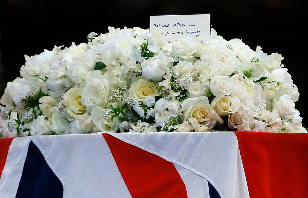 . A view shows flowers atop the Union-Flag-draped coffin of former prime minister Margaret Thatcher during her funeral at St Paul\'s Cathedral in London April 17, 2013. Thatcher, who was Conservative prime minister between 1979 and 1990, died on April 8 at the age of 87.  REUTERS/Kirsty Wigglesworth/Pool
