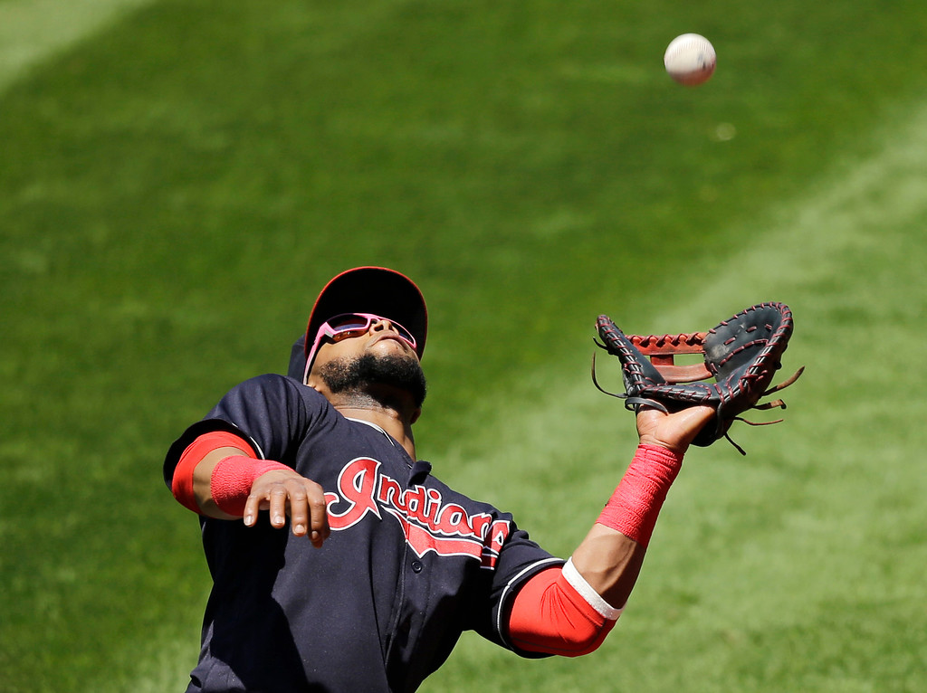 . Cleveland Indians\' Carlos Santana catches a fly ball hit by Chicago White Sox\'s Matt Davidson in the third inning of a baseball game, Sunday, June 11, 2017, in Cleveland. Davidson was out on the play. The Indians won 4-2. (AP Photo/Tony Dejak)