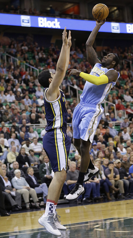 . Denver Nuggets\' J.J. Hickson, right, shoots as Utah Jazz\'s Enes Kanter, left, of Turkey, defends in the first quarter during an NBA basketball game Monday, Nov. 11, 2013, in Salt Lake City.  (AP Photo/Rick Bowmer)