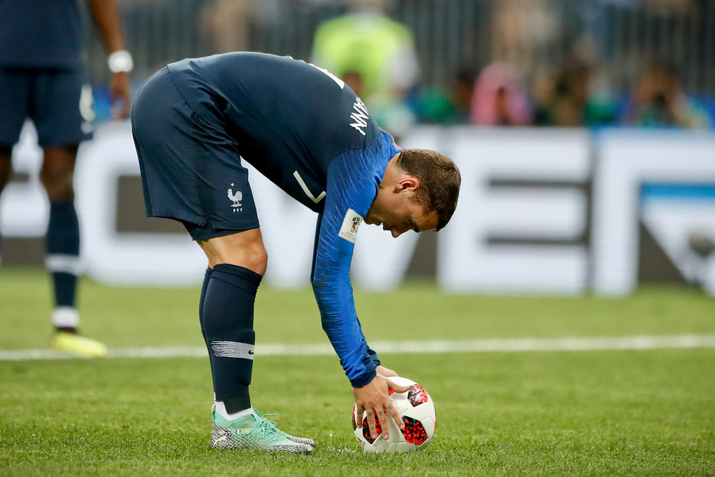 . France\'s Antoine Griezmann places the ball to kick a penalty kick during the final match between France and Croatia at the 2018 soccer World Cup in the Luzhniki Stadium in Moscow, Russia, Sunday, July 15, 2018. (AP Photo/Matthias Schrader)