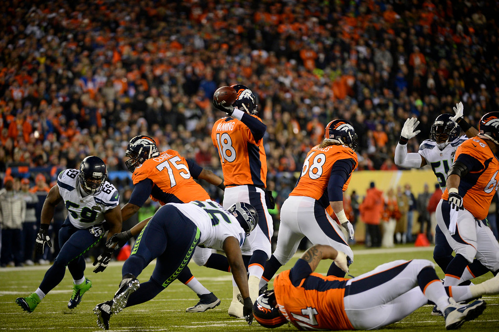 . Denver Broncos quarterback Peyton Manning (18) under pressure during the first quarter. The Denver Broncos vs the Seattle Seahawks in Super Bowl XLVIII at MetLife Stadium in East Rutherford, New Jersey Sunday, February 2, 2014. (Photo by Joe Amon/The Denver Post)