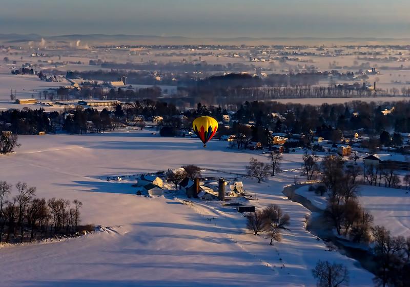 hot air balloon tour - yellow balloon over farm(p).jpg
