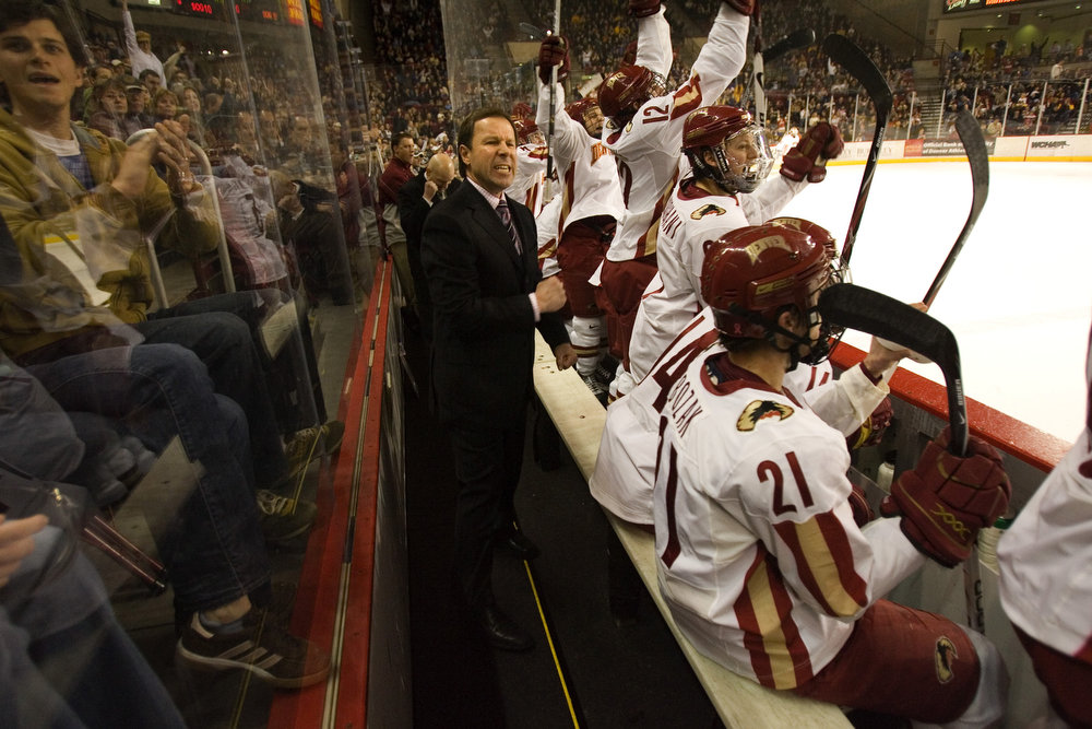 . University of Denver coach George Gwozdecky leads the Pioneers to 4-1 victory over the number 5 Minnesota Golden Gophers Sat., Feb. 9 at home.  The Pioneers recently lost their lead scorer, Brock Trotter, to the pros.  Trotter signed with the Montreal Canadiens on Thursday, Feb. 7. Here, Gwozdecky celebrates the first goal of the game that was produced late in the first period. (Nathan W. Armes/Special to The Denver Post)
