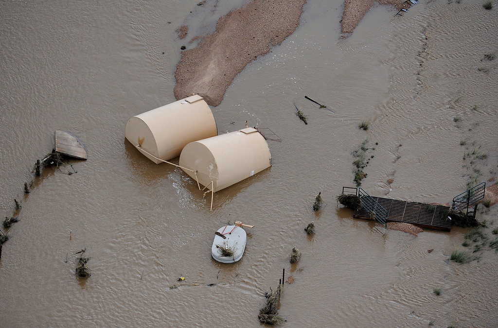 . WELD COUNTY, CO. - SEPTEMBER 16:  Debris from an destroyed oil and gas industry operation near Greeley in water flooded by the South Platte River. Aerial photographs of the Platte River flooding cities and farms in Weld County Colorado. (Photo By Tim Rasmussen/The Denver Post)
