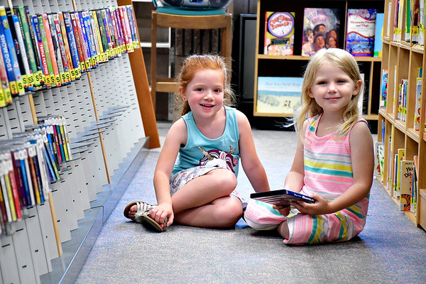 7/3/2019 Mike Orazzi | Staff Friends Abby Whitney,5, and Olivia Burch,4, while at the Manross Library in Bristol on Wednesday.