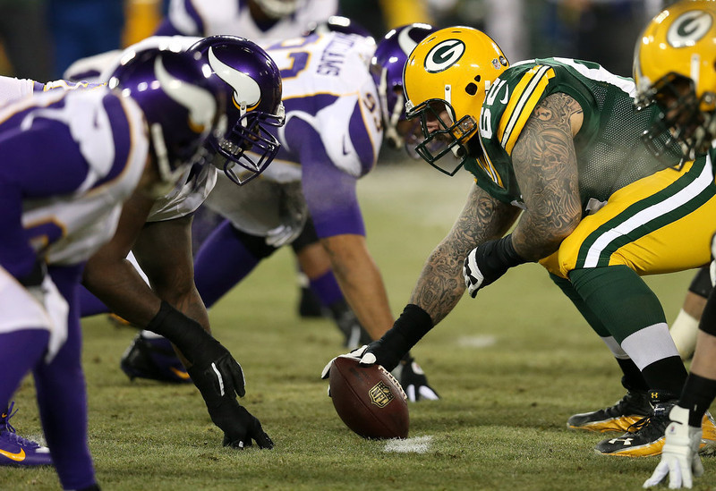 . Guard Evan Dietrich-Smith #62 of the Green Bay Packers waits to snap the football against the Minnesota Vikings in the first quarter during the NFC Wild Card Playoff game at Lambeau Field on January 5, 2013 in Green Bay, Wisconsin.  (Photo by Jonathan Daniel/Getty Images)