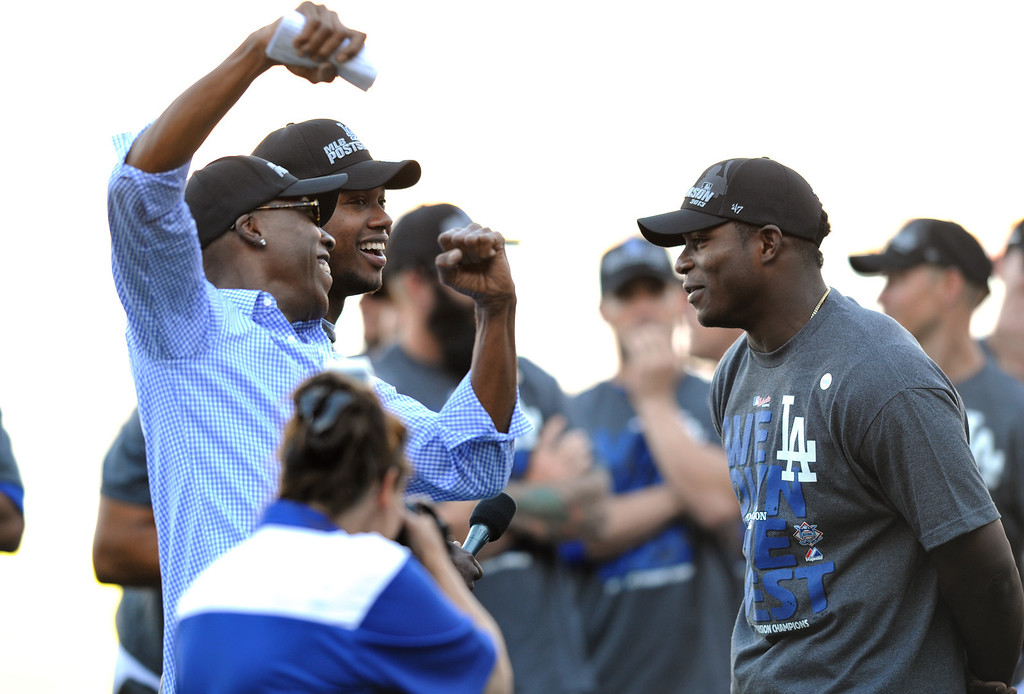 . Arsenio Hall, left, and Dodgers\' shortstop Hanley Ramirez   joke with Yasiel Puig during a post-game rally after their baseball game against the Colorado Rockies, Sunday, Sept. 29, 2013, at Dodger Stadium. (Photo by Michael Owen Baker/L.A. Daily News)