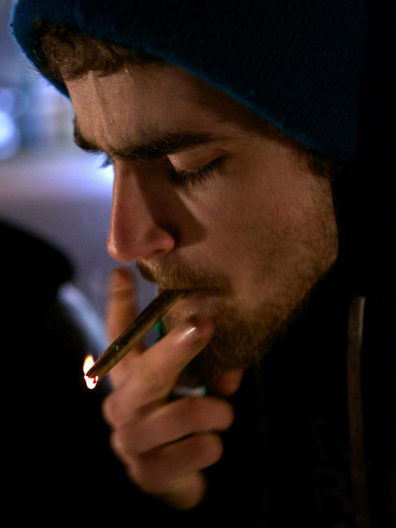 . A Tacoma resident smokes marijuana shortly after a law legalizing the recreational use of  marijuana took effect on December 6, 2012 in Seattle, Washington.  Voters approved an initiative to decriminalize the recreational use of marijuana making it one of the first states to do so. (Photo by Stephen Brashear/Getty Images)