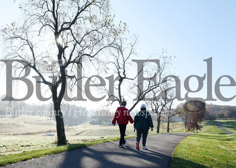 Harold Aughton/Butler Eagle: Longtime friends and neighbors Jan Tedesco, left, and Kathy Soriano take a brisk morning walk Monday morning in Cranberry Twp. Park.