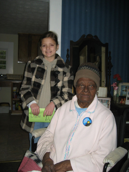 """09 12-12 Ms. Fannie Smith with Lillie Barnes Ogata. Instead of traditional birthday presents, Lillie requested donations to the Chattahoochee Fuller Center Project. After the party, she presented $137 to help fund a """"Greater Blessings"""" home renovation such as one recently completed for """"Ms. Fannie."""" bs"""