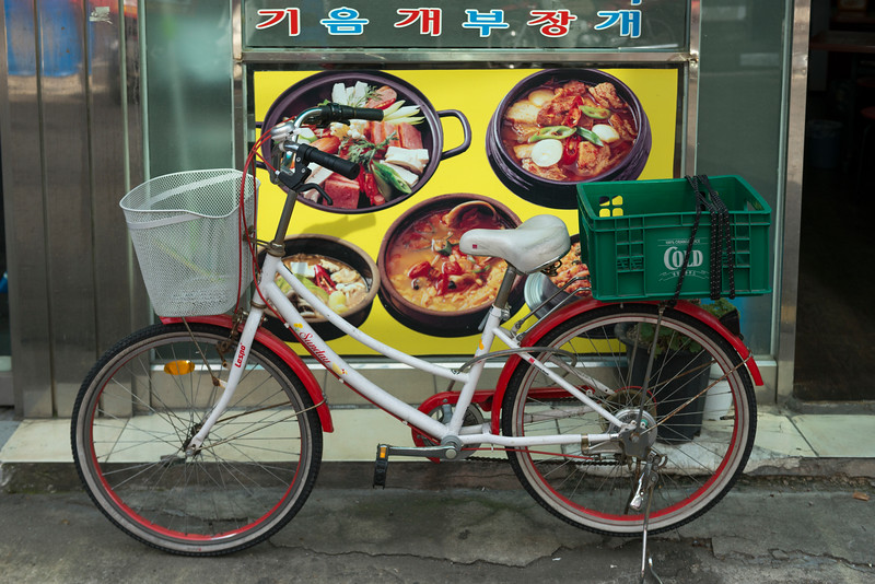 Bicycle parked in front of a restaurant, Seoul, South Korea