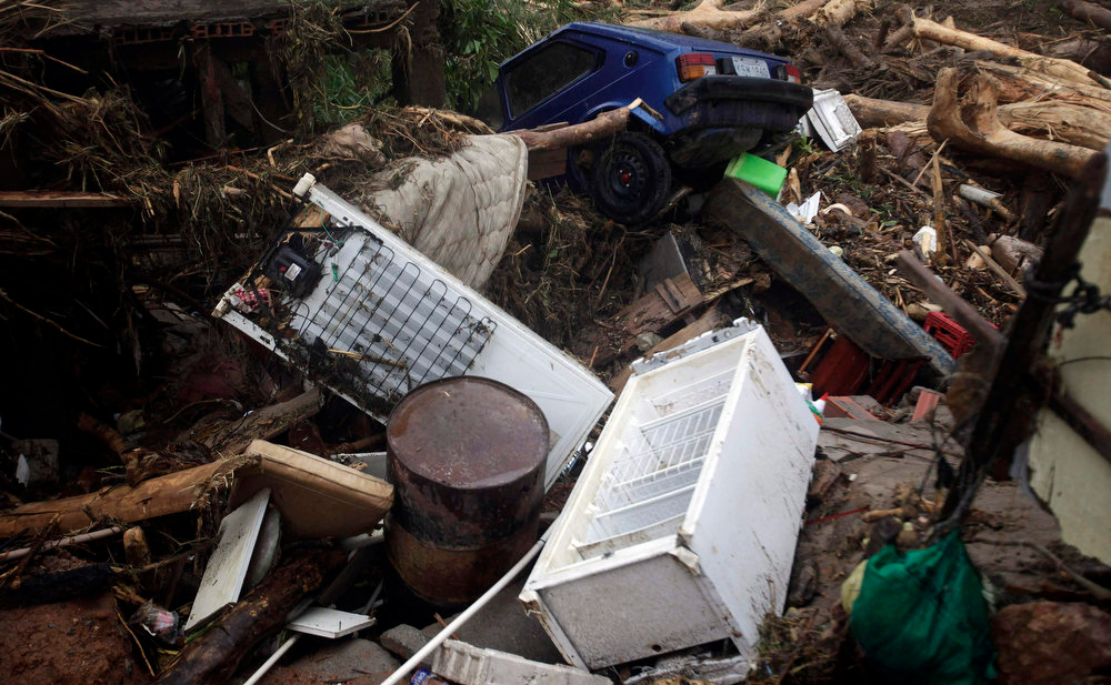 Description of . A view of a damaged area by the floods of the Capivari river in Xerem, in Duque de Caxias near Rio de Janeiro January 3, 2013.  At least 255 people were dislodged and one person died during the floods of Capivari River in Xerem, a district of Duque de Caxias, local media said.  REUTERS/Ricardo Moraes