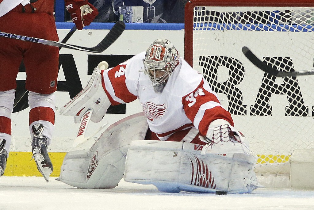 . Detroit Red Wings goalie Petr Mrazek (34), of the Czech Republic, reaches for the puck during the first period of Game 7 of a first-round NHL hockey playoff series against the Tampa Bay Lightning, Wednesday, April 29, 2015, in Tampa, Fla. (AP Photo/Chris O\'Meara)
