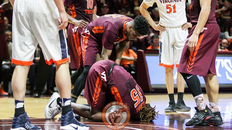 Chris Clarke lays on the floor after landing awkardly on his leg. (Mark Umansky/TheKeyPlay.com)