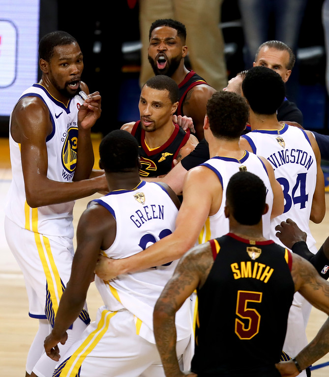 . Cleveland Cavaliers center Tristan Thompson, top, yells at Golden State Warriors forward Draymond Green, bottom, during overtime of Game 1 of basketball\'s NBA Finals in Oakland, Calif., Thursday, May 31, 2018. The Warriors won 124-114. (AP Photo/Ben Margot)