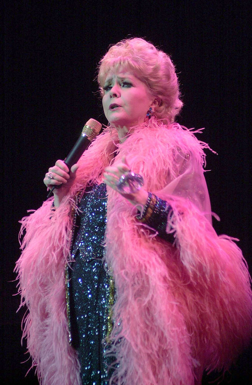 . Singer Debbie Reynolds performs at a concert for the Salvation Army Nancy Painter Home Benefit at Wilshire Ebell Theater November 23, 2003 in Los Angeles, California.  (Photo by Ringo H.W. Chiu/Getty Images)