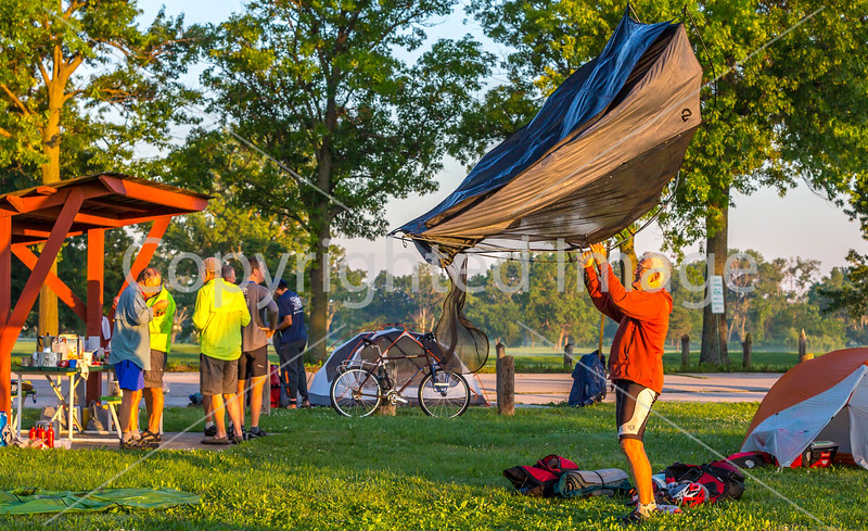 4-A)  Cyclists Breaking Camp