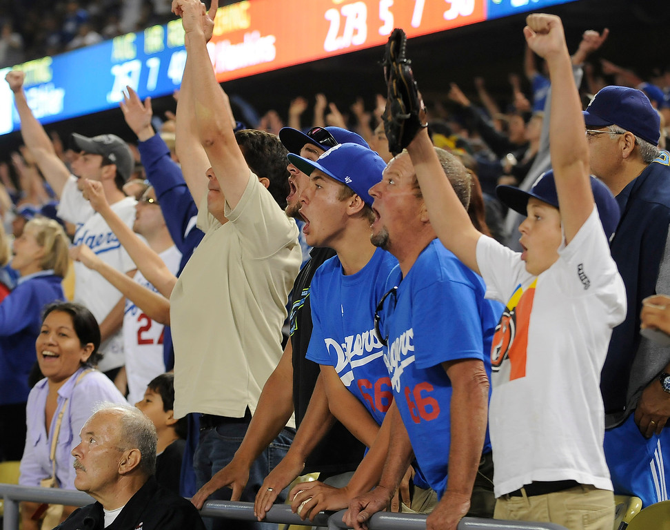 . Fans react to a 9th inning home run by Andre Ethier in the 9th inning that tied the game. Fans at Dodger Stadium have been treated to a lot of excitement. The Dodgers defeated the New York Mets 5-4 in 12 innings Wednesday night at Dodger Stadium in Los Angeles, CA. 8/13/2013(John McCoy/LA Daily News)