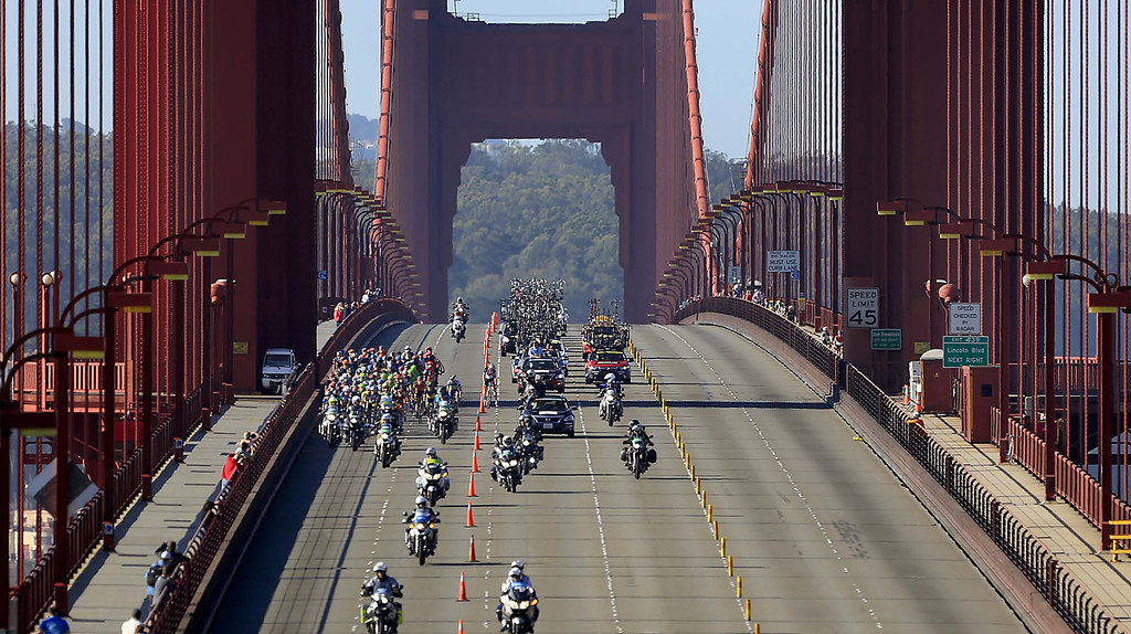 . Closed to traffic, the Tour of California peloton rolls over the Golden Gate Bridge  Sunday May 19, 2013, on the way from San Francisco to Santa Rosa, Ca.,  during the eighth and final stage of the race.    (AP Photo/The Press Democrat,Kent Porter )
