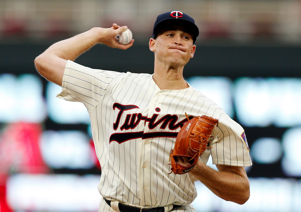 . Minnesota Twins pitcher Aaron Slegers, making his major league debut, throws against the Cleveland Indians during the first inning of the second game of a baseball doubleheader Thursday, Aug. 17, 2017, in Minneapolis. (AP Photo/Jim Mone)