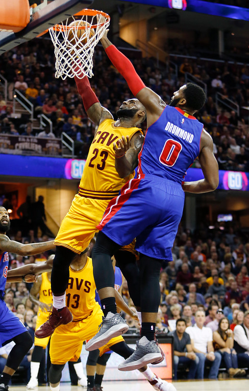 . Cleveland Cavaliers\' LeBron James (23) goes up for a shot against Detroit Pistons\' Andre Drummond (0) during the first half of an NBA basketball game Friday, Nov. 18, 2016, in Cleveland. The Cavaliers won 104-81. (AP Photo/Ron Schwane)