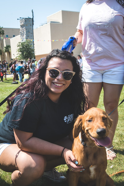Student Jacqueline Bird poses for a photo with her dog at the Islander Music Festival.
