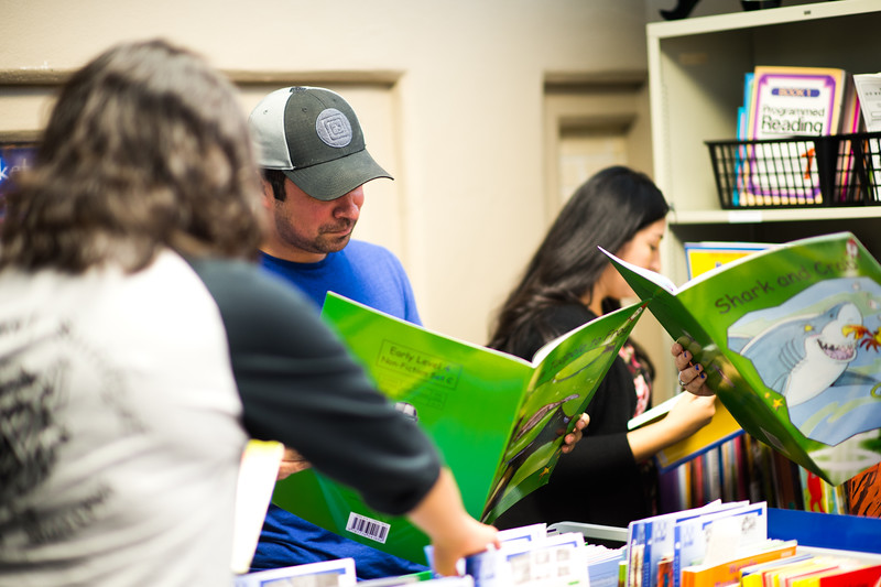 """Thomas Cantu reading over """"Tadpole to Frog"""" at the Curriculum and Instruction Resource Library"""