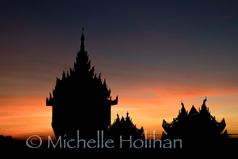 Silohuettes of outer buildings at Shwedagon Pagoda at sunrise in Yangon, Myanmar
