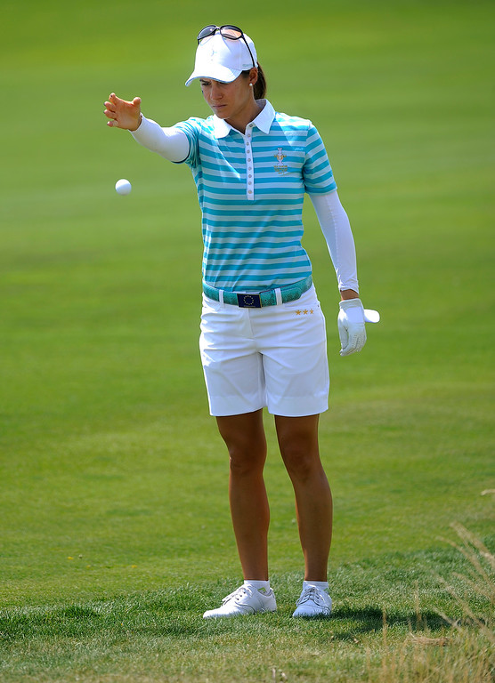 . PARKER, CO. - AUGUST 17: Spanish golfer Azahara Munoz was forced to take a drop on the 18th hole after the European team hit a shot from a bunker into a unplayable position in a yucca plant at the Solheim Cup Saturday. The American pairing of Paula Creamer and Stacy Lewis went one up on the Europeans in the morning competition. It was the American Team versus the Europeans as play continued at the Colorado Golf Club Saturday afternoon, August 17, 2013. Photo By Karl Gehring/The Denver Post