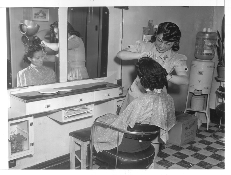 """""""A scene in the Ginza Beauty Salon in Japan Town, Los Angeles.  Meiko Fujihiro (Nisei) is getting a hairdo from Jane Kaku (Nisei), manager of the beauty parlor.""""--caption on photograph"""