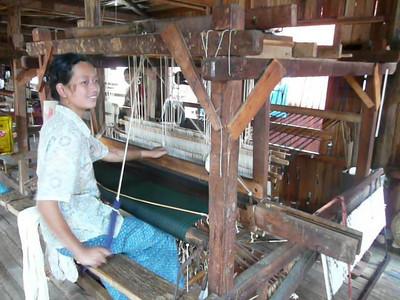 Myanmar Inle Lake girl on loom